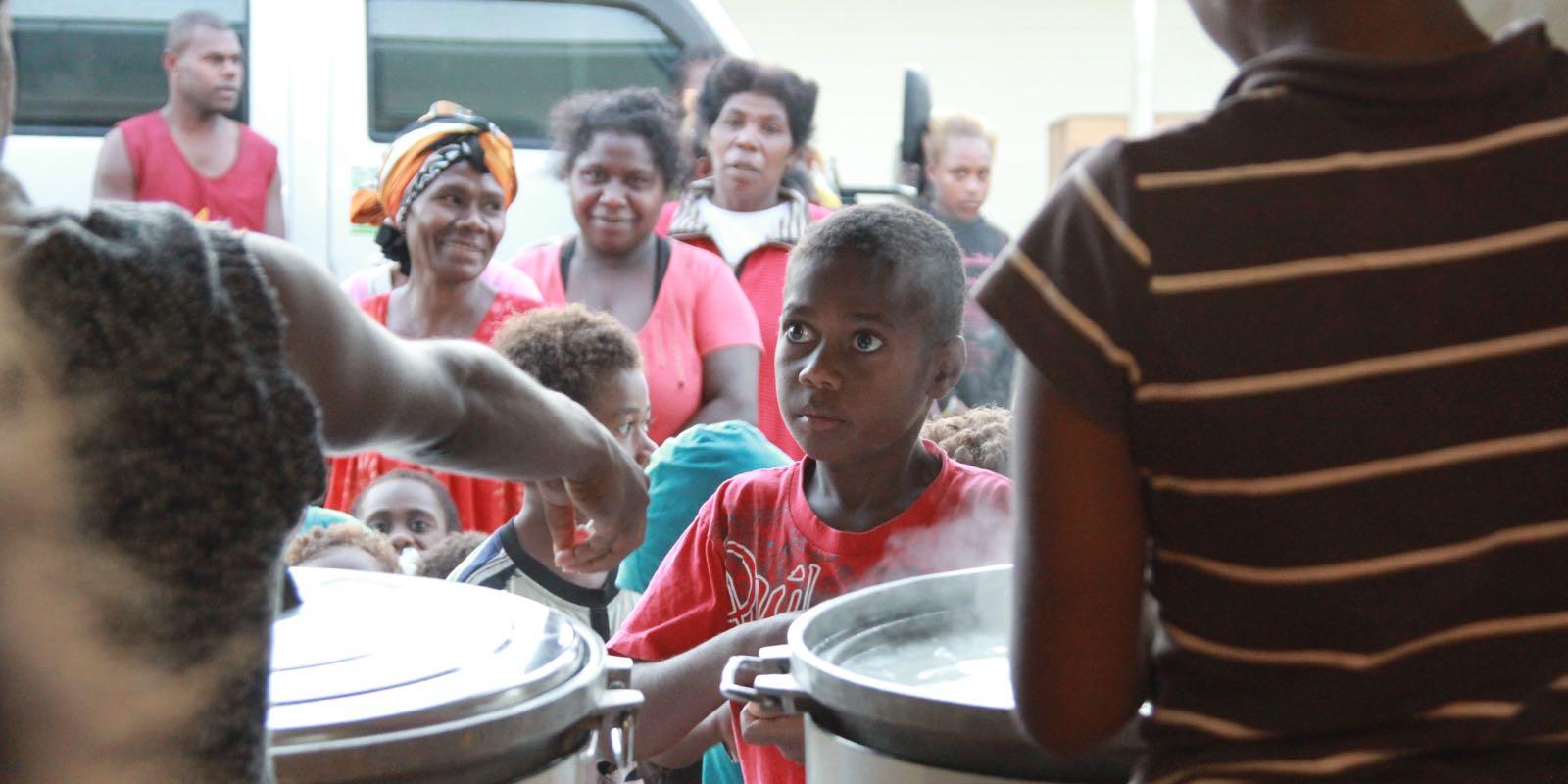 Vanuatu_feeding_young_boy
